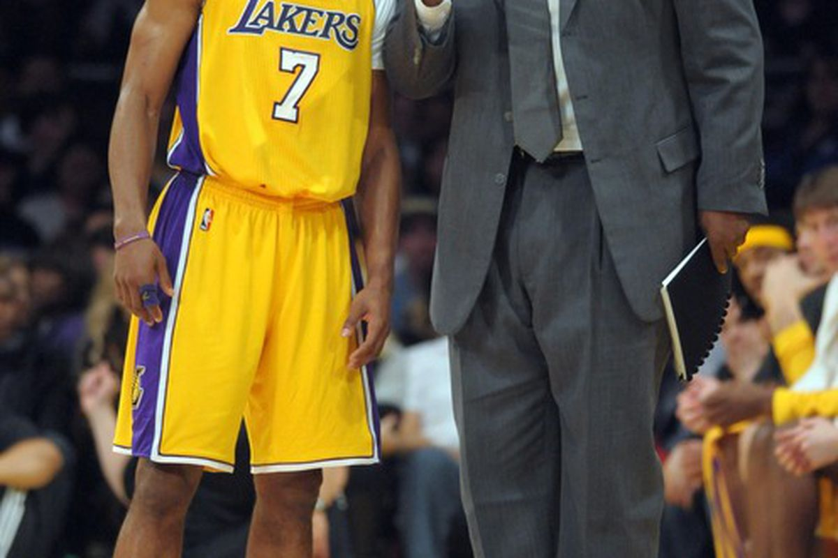 Chuck Person telling Ramon Sessions where to get the best hotdogs in the arena.