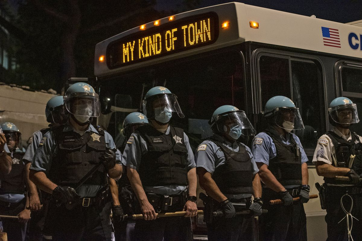 Chicago police officers used a CTA bus to help block Michigan Avenue during a protest march near CPD headquarters on June 4, 2020.