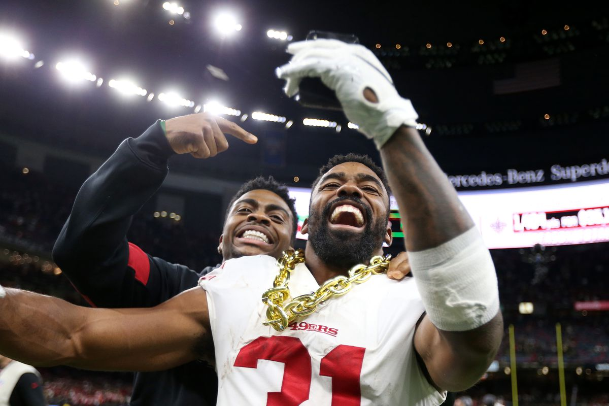 San Francisco 49ers running back Raheem Mostert celebrates with a teammate after their win against the New Orleans Saints at the Mercedes-Benz Superdome.