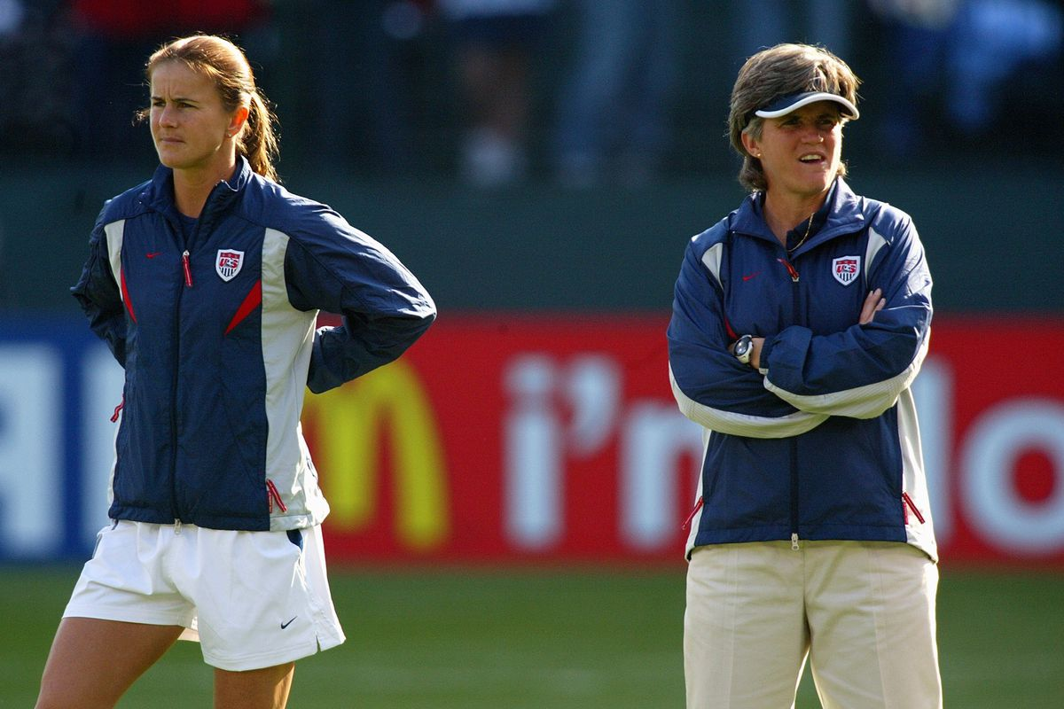 Brandi Chastain and Coach April Heinrichs look on