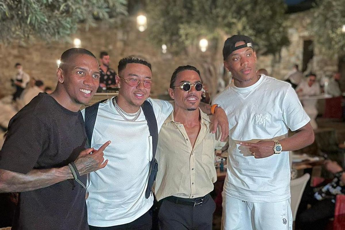 Ashley Young, Jesse Lingard, Nusret Gökçe, and Anthony Martial pose for a photograph at the Nusret Steakhouse in Mykonos, the Greek island