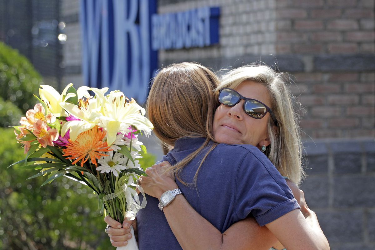 WDBJ employee Karen Loftus gets a hug from Donna Anderson, whose daughter works at the station, after a press conference about the two journalists who were killed on August 27 in Roanoke, Virginia.
