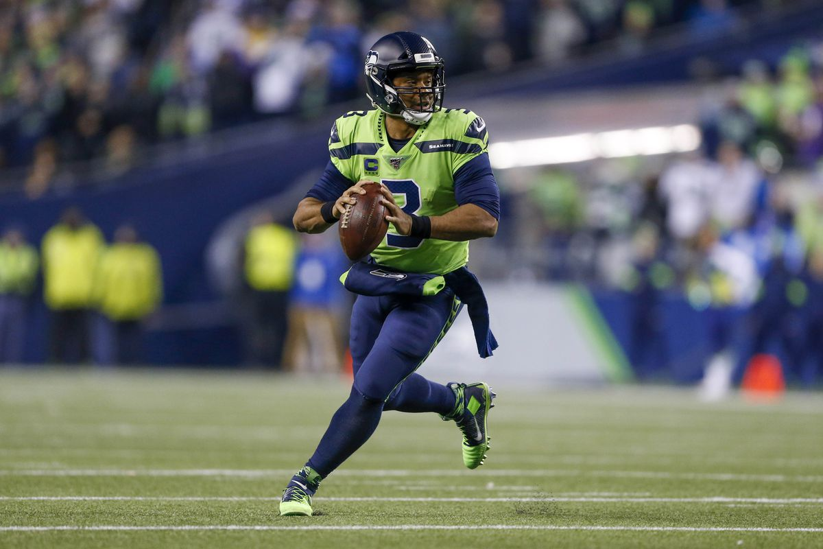 Seattle Seahawks quarterback Russell Wilson looks to pass against the Minnesota Vikings during the third quarter at CenturyLink Field.