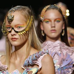 A model wears a creation for Indian fashion designer Manish Arora's ready to wear Spring-Summer 2013 collection, presented in Paris, Thursday, Sept.27, 2012.
