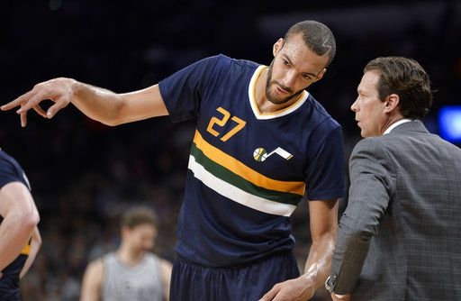 20170403 Utah Jazz center Rudy Gobert, left, talks to Jazz head coach Quin Snyder during the first half of an NBA basketball game against the San Antonio Spurs, Sunday, April 2, 2017, in San Antonio. San Antonio won 109-103. (AP Photo/Darren Abate) Darren Abate Rudy Gobert, Quin Snyder FR115 AP