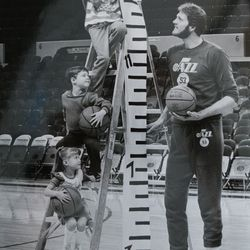 Historical photo of former Utah Jazz center Mark Eaton during a Primary Children's Hospital Pennies by the Inch fundraising campaign.