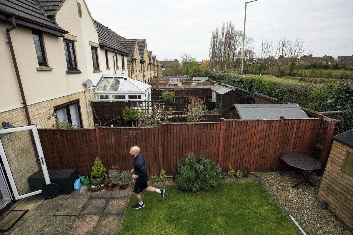 James Campbell runs a charity marathon in his garden in Cheltenham, England, while the country is in lockdown.