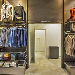 Fitting rooms are located on the far right of the store.