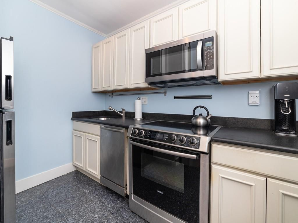 A small kitchen with a single counter.
