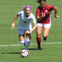 Kansas State midfielder Maddie Souter (36) and Oklahoma's Kaylee Dao (11) jockey for a ball during the Wildcats' loss to the Sooners on Sunday, Sept. 23, 2018, in Manhattan.
