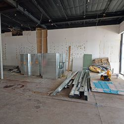 The entry way and future bar are straight ahead. A separate door will provide guests with direct access to the bar.