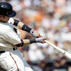 San Francisco Giants' Buster Posey singles against the Arizona Diamondbacks during the third inning of a baseball game, Thursday, Sept. 27, 2012, in San Francisco.
