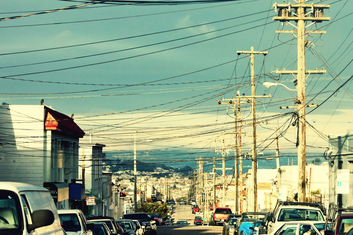 Telephone poles and lines on an Excelsior street.