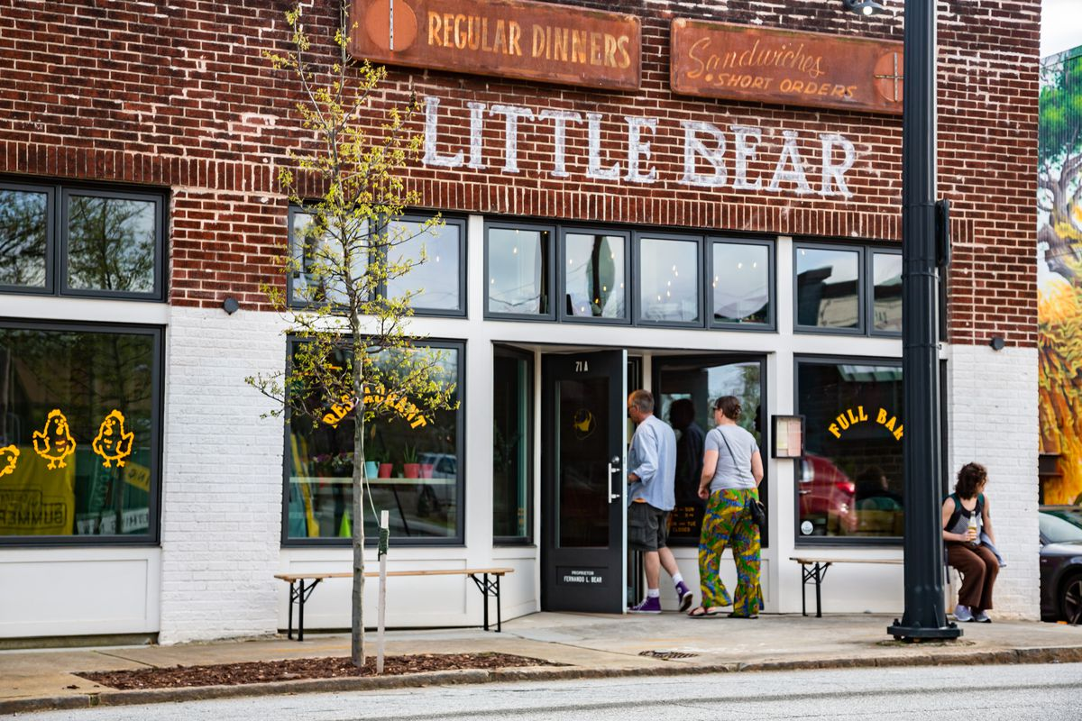 Two people walking into Little Bear on Georgia Avenue in Summerhill Atlanta to grab takeout amid COVID-19 on March 21