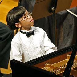Trenton Chang performs Mozart's Piano Concerto N. 17 in G Major, during the 50th anniversary Salute to Youth concert Tuesday in Salt Lake City.
