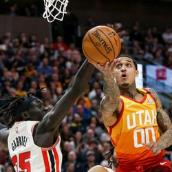 Portland Trail Blazers forward Wenyen Gabriel (35) attempts to block Utah Jazz guard Jordan Clarkson (00) going for a layup at Vivint Smart Home Arena in Salt Lake City on Friday, Feb. 7, 2020.