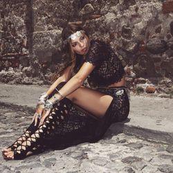 For Love & Lemons black lace crop top, $123; black lace maxi skirt, $200