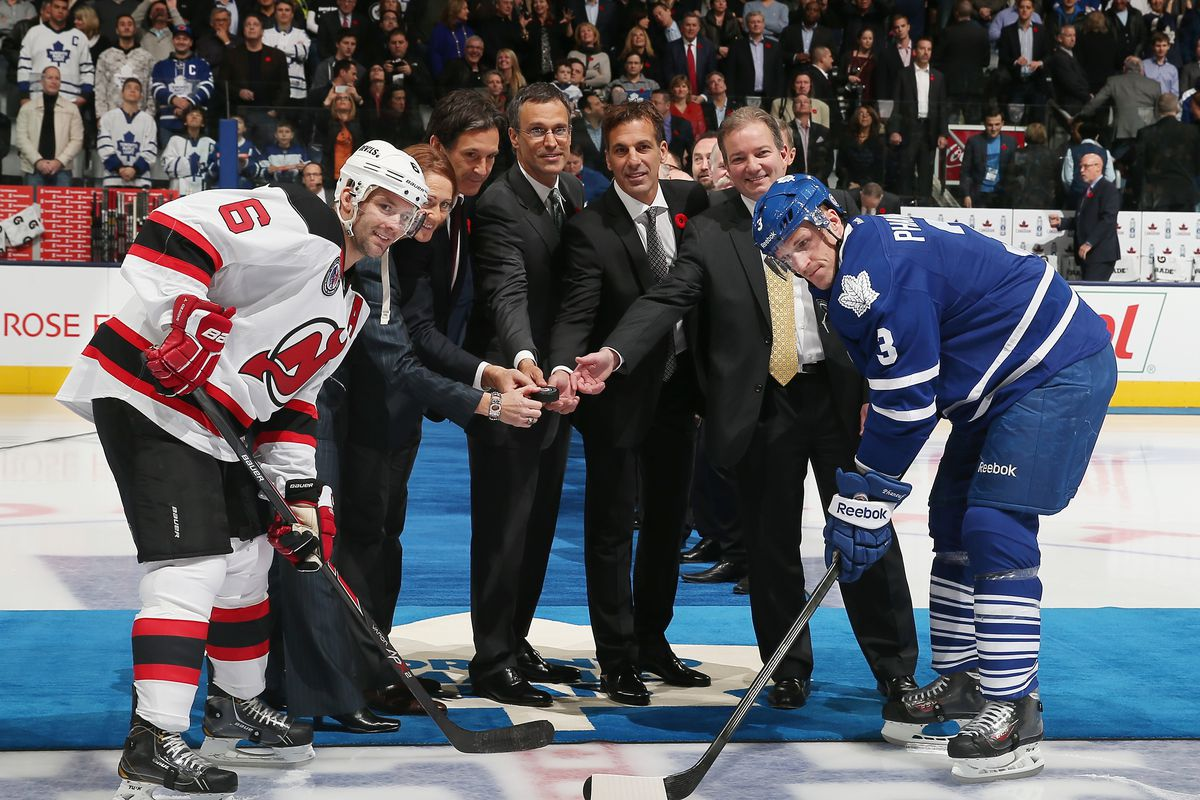 Ray Shero (right, behind Dion Phaneuf) is now the GM of the Devils. What happens now? Let's discuss what could change.