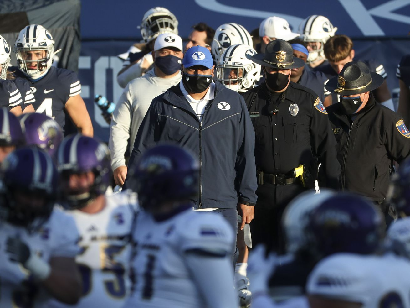 BYU head football coach Kalani Sitake, center, walks onto the field with his team after the Cougars defeated North Alabama in Provo on Saturday, Nov. 21, 2020.