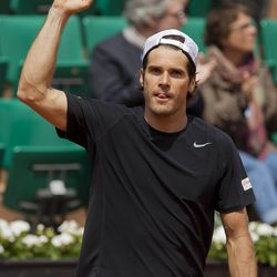 Tommy Haas celebrates after recording match point against Mikhail Youzhny at the 2013 French Open.