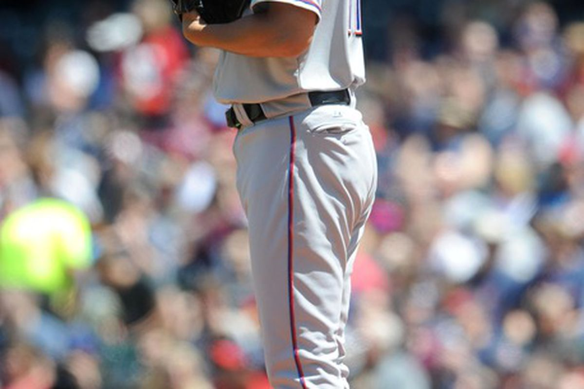 May 6, 2012; Cleveland, OH, USA: Texas Rangers starting pitcher Yu Darvish (11) prepares to pitch in the first inning against the Cleveland Indians at Progressive Field.  Mandatory Credit: Eric P. Mull-USPRESSWIRE