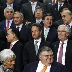 Tresasury Secretary Timothy Geithner, center, stands during a G-20 finance ministers and central bank governors group photo after their meeting at the IMF and World Bank Group Spring Meetings in Washington, Friday, April 20, 2012. Also pictured are International Monetary Fund (IMF) managing director Christine Lagarde, bottom row left, Mexico central bank governor Agustin Carstens, bottom row center.