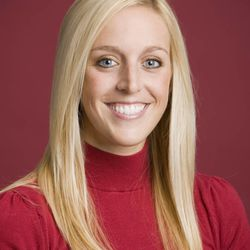 FILE - In this undated image released by the University of Arkansas, Razorback Foundation assistant director Jessica Dorrell poses for a photo. Arkansas has fired Bobby Petrino as football coach on Tuesday, saying he engaged in reckless behavior. The 51-year-old Petrino was injured in an April 1 motorcycle accident. He was put on paid leave last week after admitting he lied about the presence of the 25-year-old employee, Dorrell, who had been riding with him.