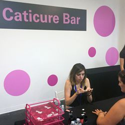 Guests got mini manis at the caticure bar.