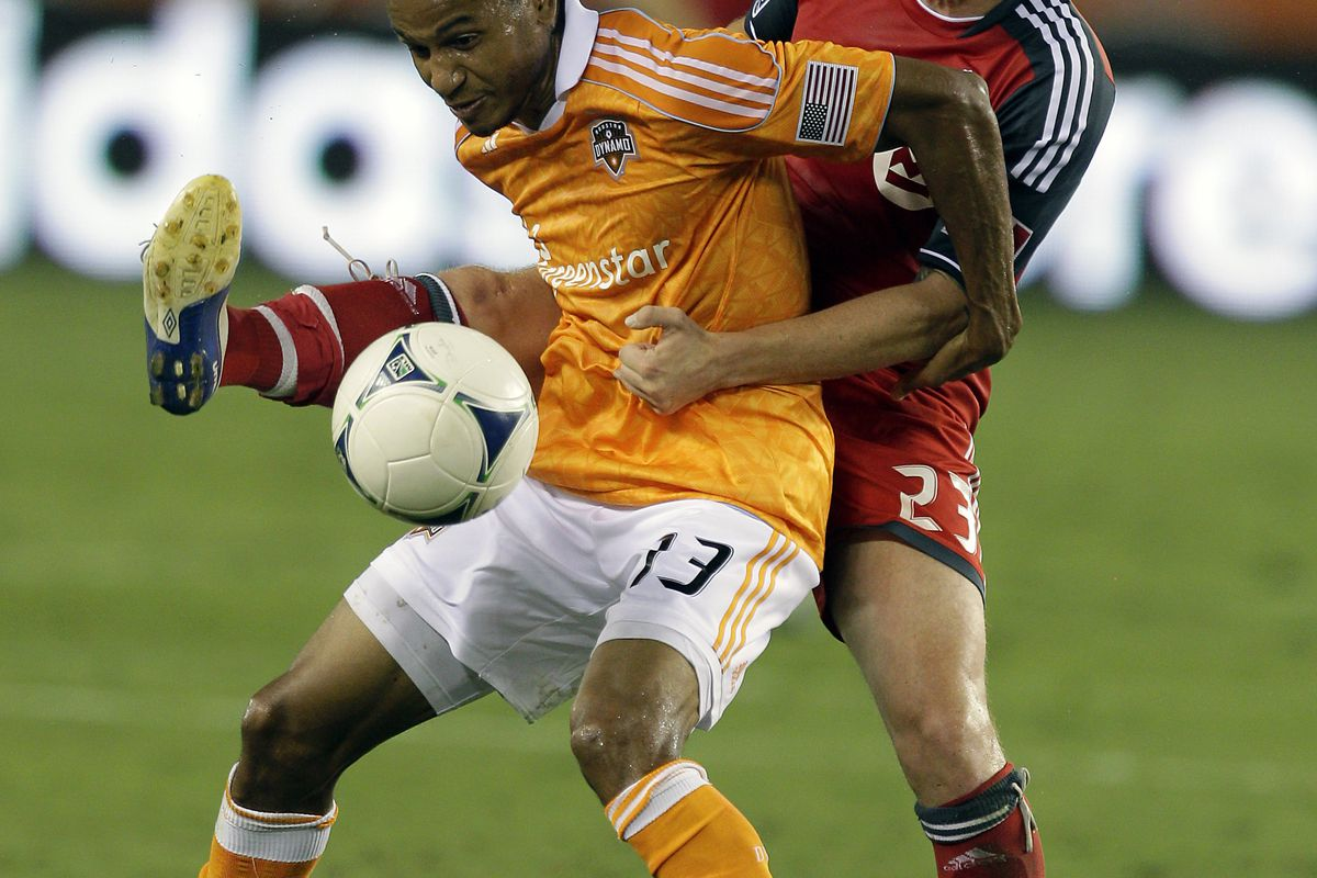 HOUSTON, TX. - AUGUST 25: Ricardo Clark #13 of the Houston Dynamo battles with Terry Dunfield #23 of Toronto FC for possession of the ball at BBVA Compass Stadium on August 25, 2012 in Houston, Texas. (Photo by Bob Levey/Getty Images)