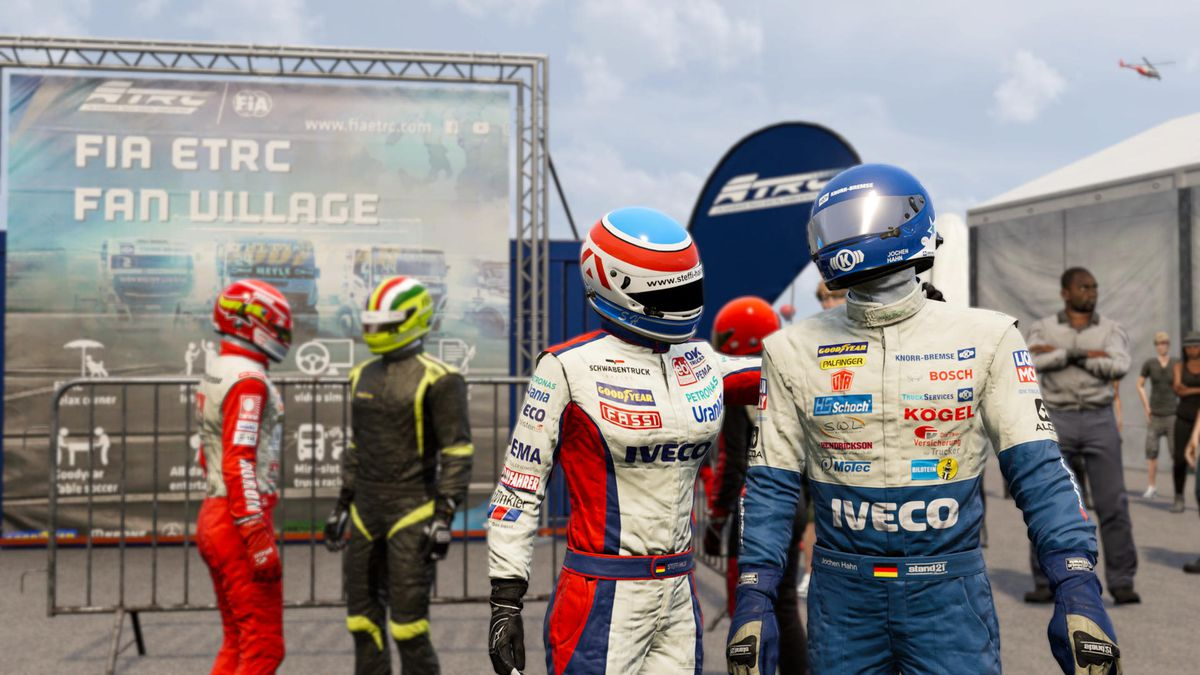 Screenshot of drivers Steffi Halm and Jochen Hahn in the paddock for FIA European Truck Racing Championship