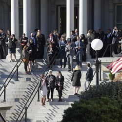 Reporters stand on the steps of the Eisenhower Executive Office Building on Nov. 10, 2016, waiting for the arrival of President-elect Donald Trump for his meeting with President Barack Obama.