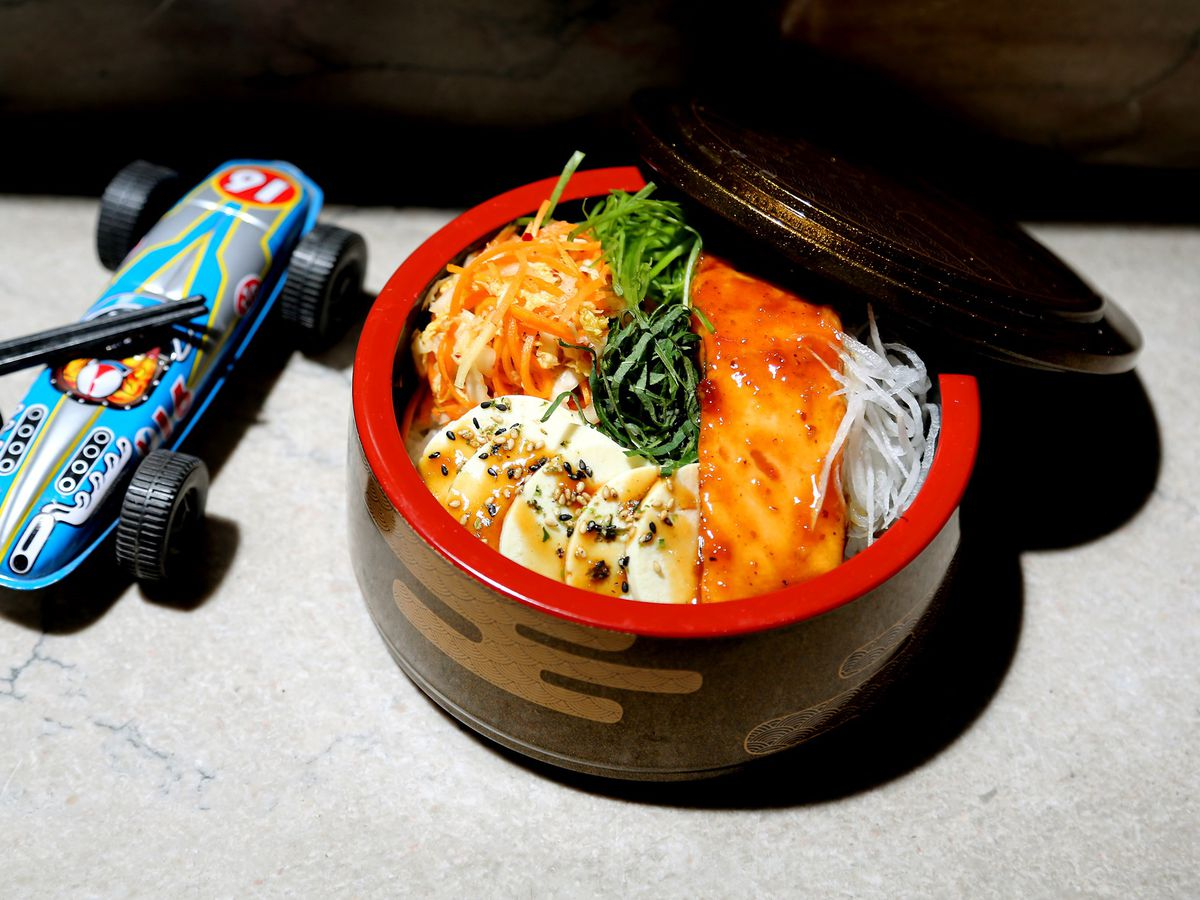 A Japanese breakfast bowl with grilled fish, soft eggs, rice, pickles, and herbs  from Cafe Spoken