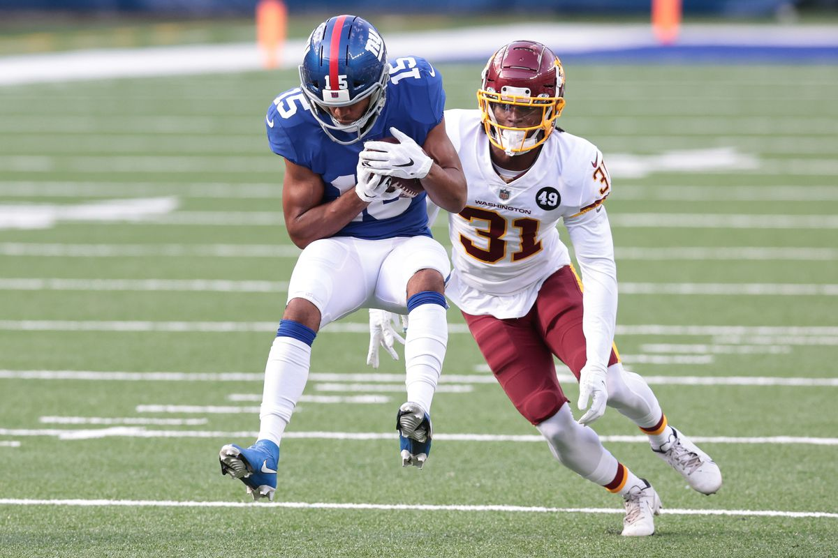 New York Giants wide receiver Golden Tate (15) catches a pass in front of Washington Football Team safety Kamren Curl (31) during the second half at MetLife Stadium.