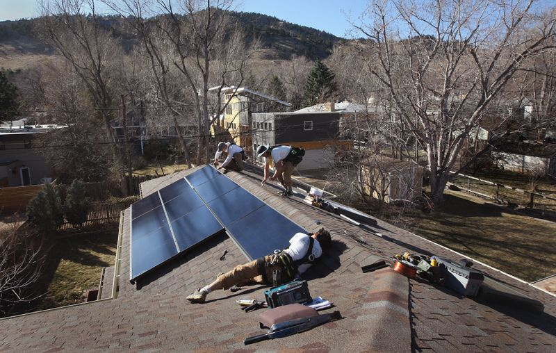 Solar Energy Panels Are Installed On Colorado Homes