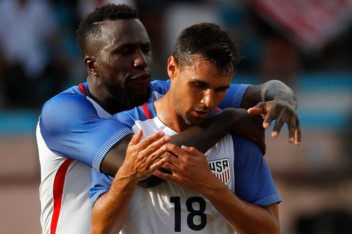 Chris Wondolowski of the United States is congratulated by Jozy Altidore after scoring the first goal against Cuba at Estadio Pedro Marrero on October 7, 2016 in Havana, Cuba.