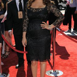FILE - In this Sat., Sept. 15, 2012 file photo, Maya Rudolph arrives at the 2012 Creative Arts Emmys at the Nokia Theatre in Los Angeles. Rudolph, nominated for a 2012 Emmy, says jokingly a bottle of champagne helps calm award show nerves.