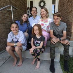 John, back left, and Lani Hilton, back right, and their children Katrina, 11, front left, Maria, 15, Rebekah, 7, and Joseph, 13, pose for a photograph at their home in Orem on Thursday, June 25, 2020.