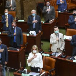 Legislators in the House of Representatives recite the Pledge of Allegiance attend a special session of the Legislature to deal with myriad COVID-19 budget changes at the Capitol in Salt Lake City on Thursday, June 18, 2020.
