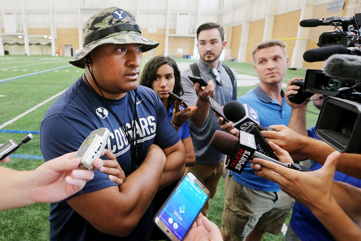 BYU head football coach Kalani Sitake talks with media after a walkthrough in their indoor practice facility in Provo on Friday, Aug. 10, 2018.