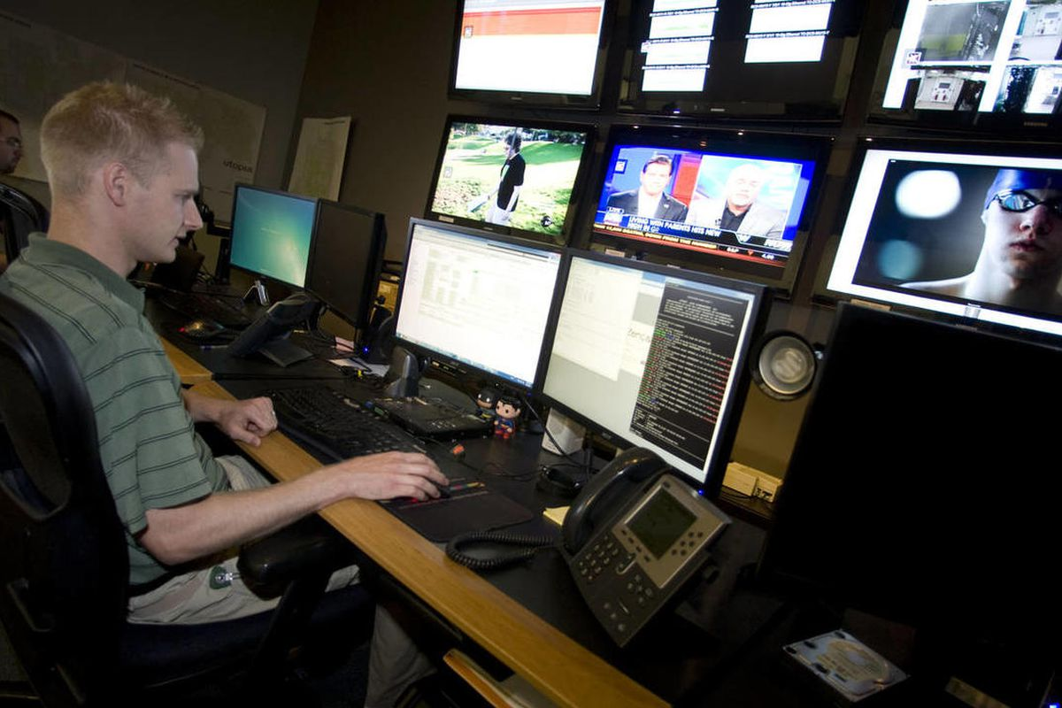 Technicians Josh Kester, front left, and Chris Adams, back left, work Wednesday, Aug. 1, 2012 in the Network Operations Center of Utopia. The UTOPIA board of directors voted Monday to proceed to the second of several proposed milestones in a deal to cede