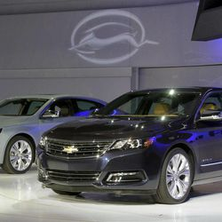 Two 2013 Chevrolet Impalas are unveiled at the New York International Auto Show, in New York's Javits Center,  Wednesday, April 4, 2012. General Motors Co.'s Chevrolet brand is trying to resuscitate sales of big sedans with a sleek, new version of the Impala.