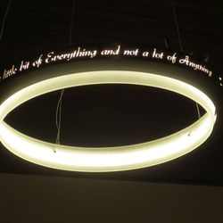 """One of six lights in the dining room. It reads, """"Taste a little bit of everything and not of lot of one thing."""""""