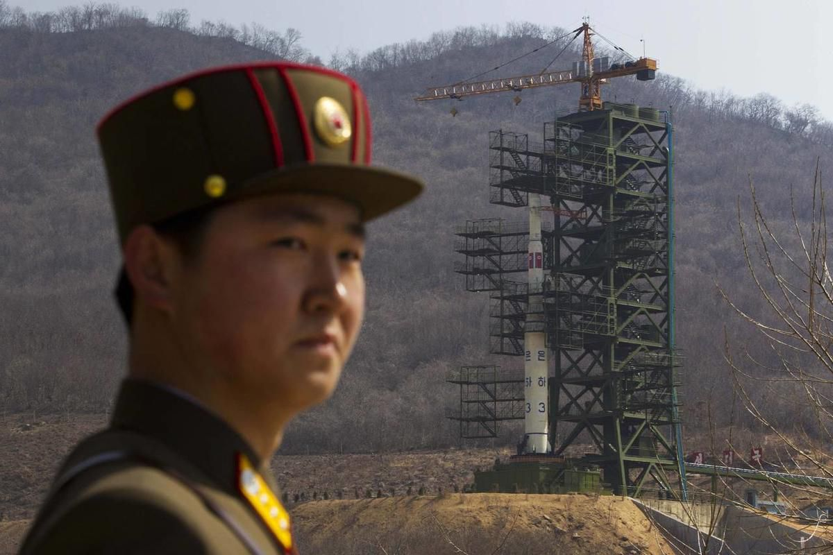 In this April 8, 2012 file photo, a North Korean soldier stands in front of the country\'s Unha-3 rocket at a launching site in Tongchang-ri, North Korea.