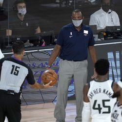 New Orleans Pelicans head coach Alvin Gentry wears a protective face covering on the sidelines during the second half of an NBA basketball game against the Utah Jazz Thursday, July 30, 2020, in Lake Buena Vista, Fla. (AP Photo/Ashley Landis, Pool)