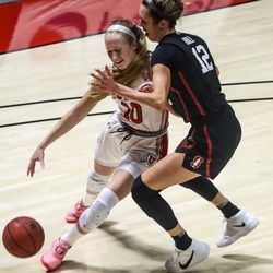 Utah Utes guard Dru Gylten (10) moves with the ball against Stanford Cardinal guard Lexie Hull (12) during a women's basketball game at the Huntsman Center in Salt Lake City on Friday, Jan. 15, 2021.