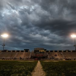 Dark clouds form as rain falls during a high school football game between Roy and West on Friday, Sept. 10, 2021, at West High School in Salt Lake City.