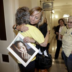 Debbie Ziegler holds a photo of her daughter, Brittany Maynard, as she receives congratulations from Ellen Pontac, after a right-to die measure was approved by the state Assembly, Wednesday, Sept. 9, 2015, in Sacramento, Calif. The bill, approved on a 42-33 vote, that would allow terminally ill patients to legally end their lives, now goes to the Senate. Brittany Maynard was the California woman with brain cancer who moved to Oregon to legally end her life last fall.