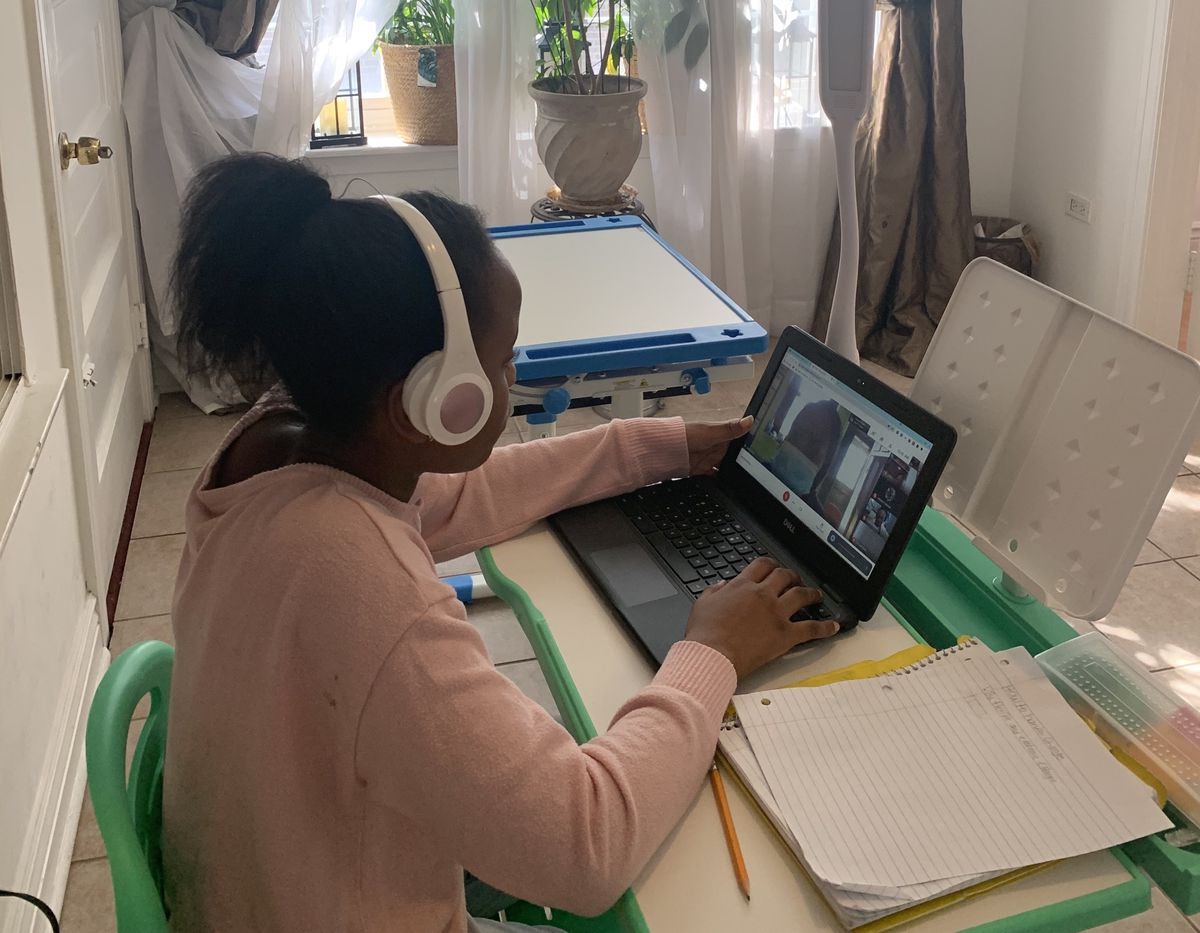 Tennille learning at her desk inside her Chicago home.