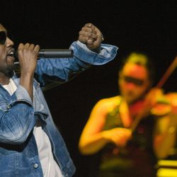 Kanye West performs at the Delta Center in Salt Lake City, Saturday Dec. 17, 2005.