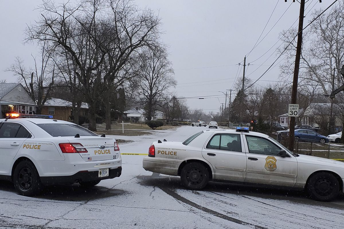 Indianapolis Metropolitan Police Department work the scene Sunday, Jan. 24, 2021 in Indianapolis where five people, including a pregnant woman, were shot to death early Sunday inside an Indianapolis home.